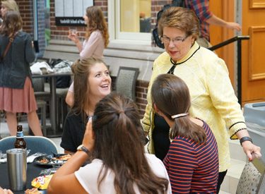 VUSN Dean Linda Norman talks to students during a welcoming picnic that was moved indoors due to inclement weather. (photo by Dina Bahan)