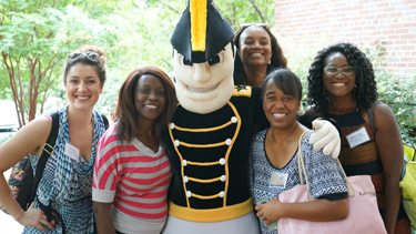 Incoming students, from left, Jade Carboy, Celine Rivers, Candace Shipp, Tiffany Chance and Cerrissa Hugie meet Mr. Commodore. (photo by Dina Bahan)
