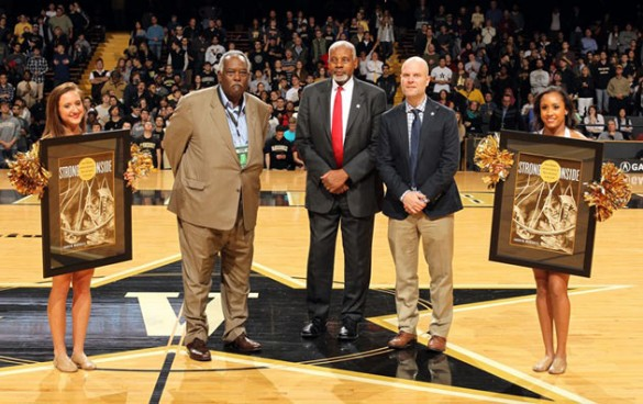 Vice Chancellor for Athletics and University Affairs and Athletics Director David Williams helped recognize Vanderbilt basketball great Perry Wallace (center) and author Andrew Maraniss during halftime of the Dec. 4 men's basketball game. (Steve Green/Vanderbilt)