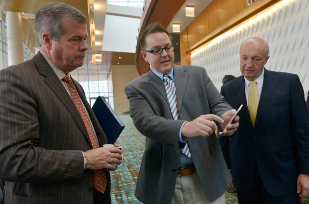 Nashville Mayor Karl Dean (left) and Vanderbilt's Jules White (center), assistant professor of electrical engineering and computer science, demonstrate the wayfinding app at the Music City Center. (Dipti Vaidya)