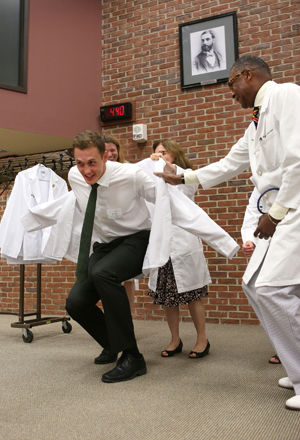 Colby Wollenman gets a little help from Bonnie Miller, M.D., and Andre Churchwell, M.D. (photo by Anne Rayner)