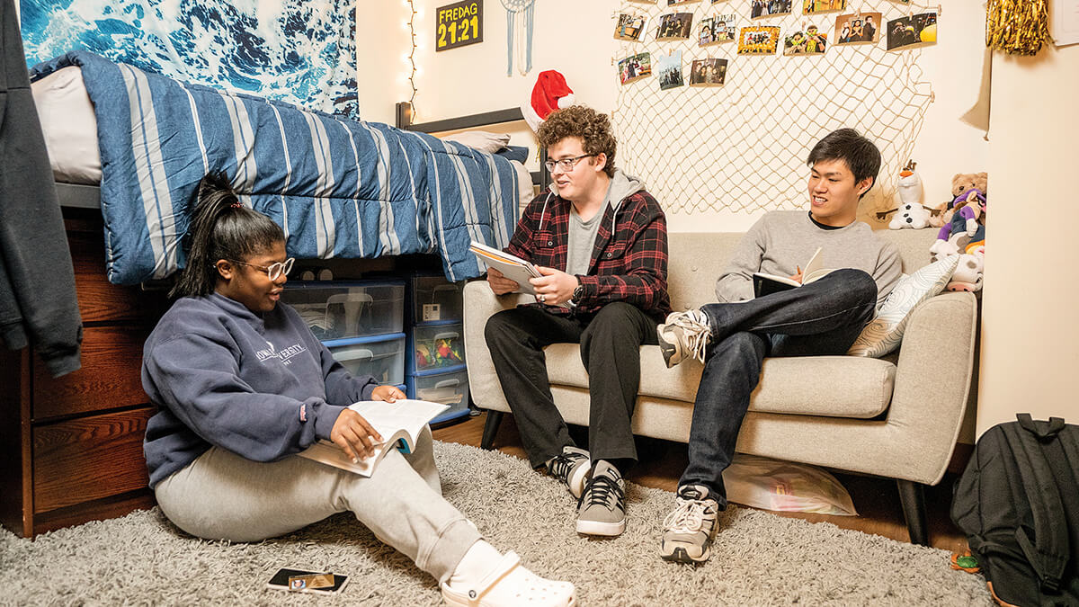 """Resident Adviser Riley Alexander (left), AJ Kolondra (center) and Walt Siv visit with each other in E. Bronson Ingram College. """"You never have to go far [in Bronson] for a good conversation with other residents or the faculty head, who personally values each and every one of those conversations,"""" Kolondra says."""