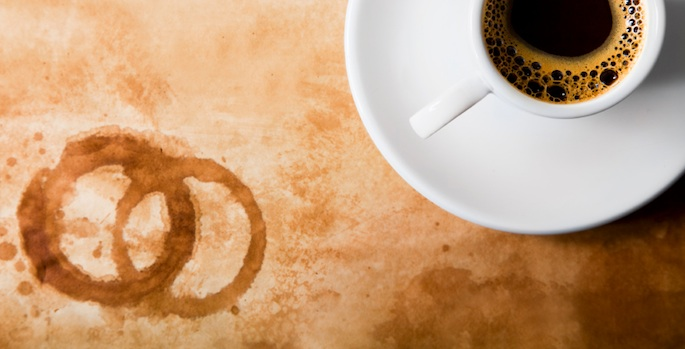 coffee cup with coffee stains on table