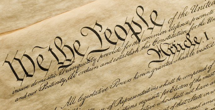 """Close up photo of """"We the People"""" portion of the U.S. Constitution"""