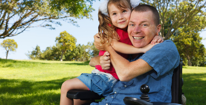 disabled man plays with his daughter