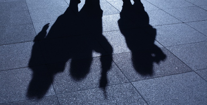 silhouette of three men with guns