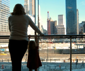 Mother and child looking at Ground Zero