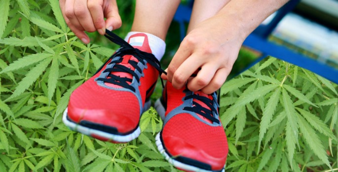 Running shoes superimposed on marijuana