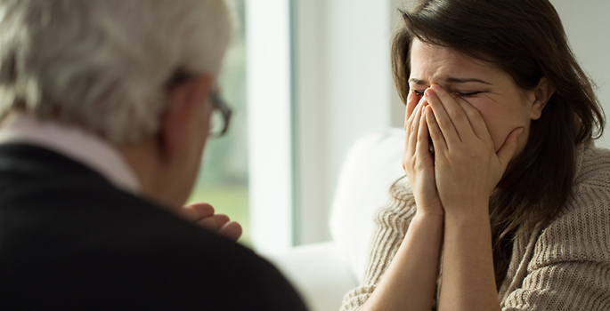 woman crying in psychotherapy