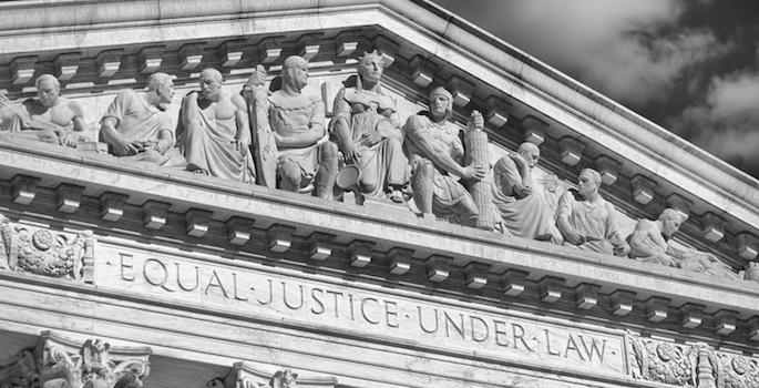 """Close-up in black and white of the message """"Equal Justice Under Law"""" inscribed in the classically detailed US Supreme Court building in Washington, DC, USA"""