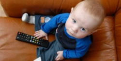 Baby holding remote