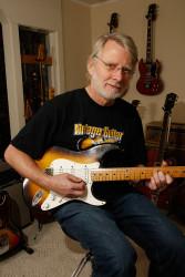 Gordon Logan playing electric guitar