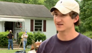 Graduating seniors help with flood clean up