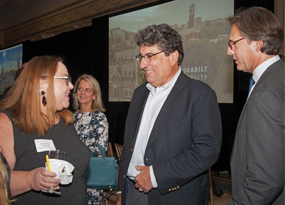 Chancellor Zeppos (center) chats with New York-area allumni at the event. Photos by Teri Bloom