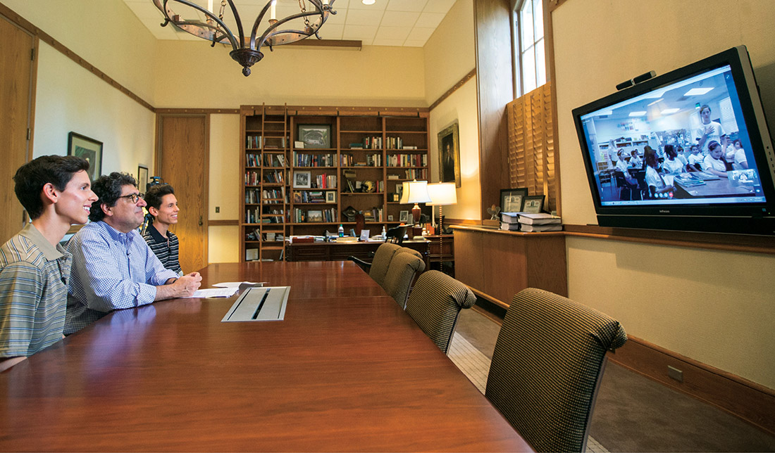 Chancellor Nicholas S. Zeppos joins first-year students Aaron and Nicholas Ainsworth in a video chat with sixth- grade students in the brothers' California hometown to encourage them to pursue college. (JOHN RUSSELL)