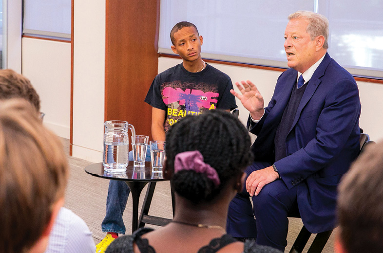 photo of Al Gore and Jaden Smith speaking to a group of students