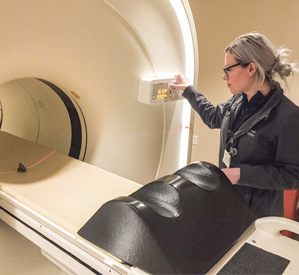 Anna Fisher, a certified nuclear medicine technologist, scans an ancient stamp using the PET/CT scanner. Photo courtesy Vanderbilt Fine Arts Gallery