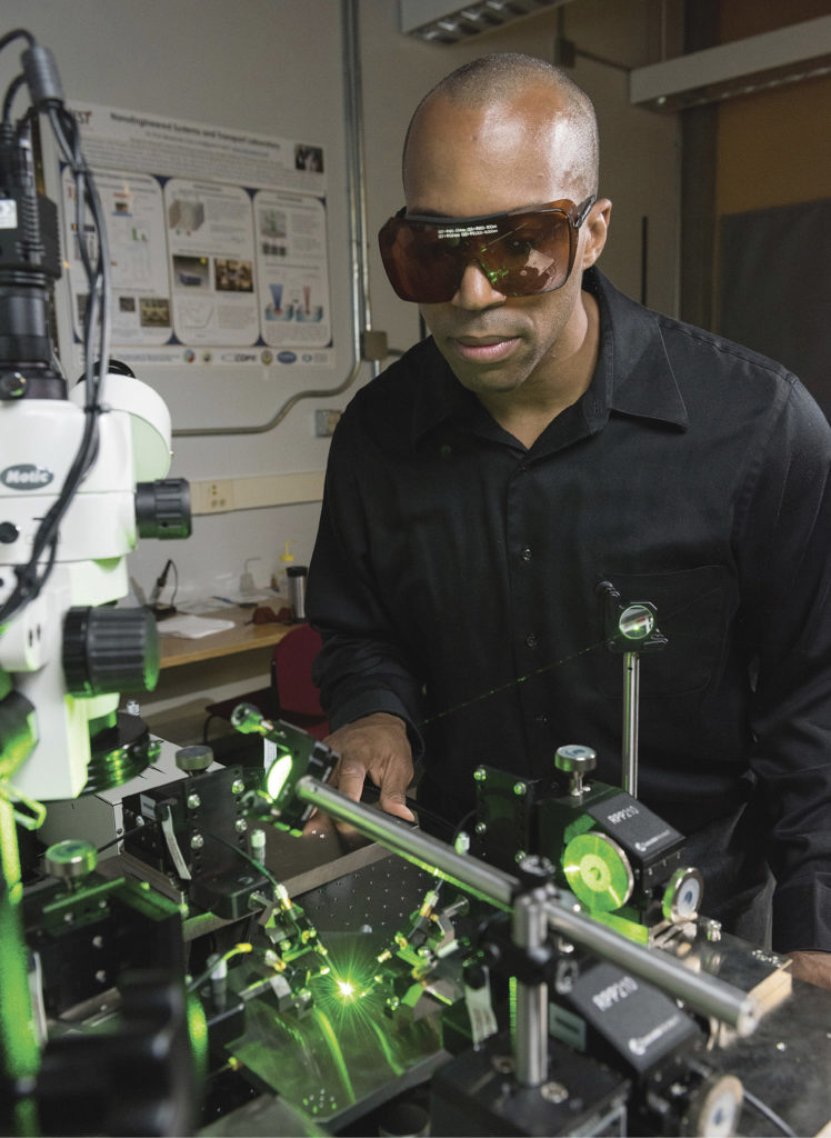 Georgia Tech associate professor Baratunde Cola measures the power produced by converting green laser illumination to electricity using the carbon nanotube optical rectenna. (ROB FELT, GEORGIA TECH)