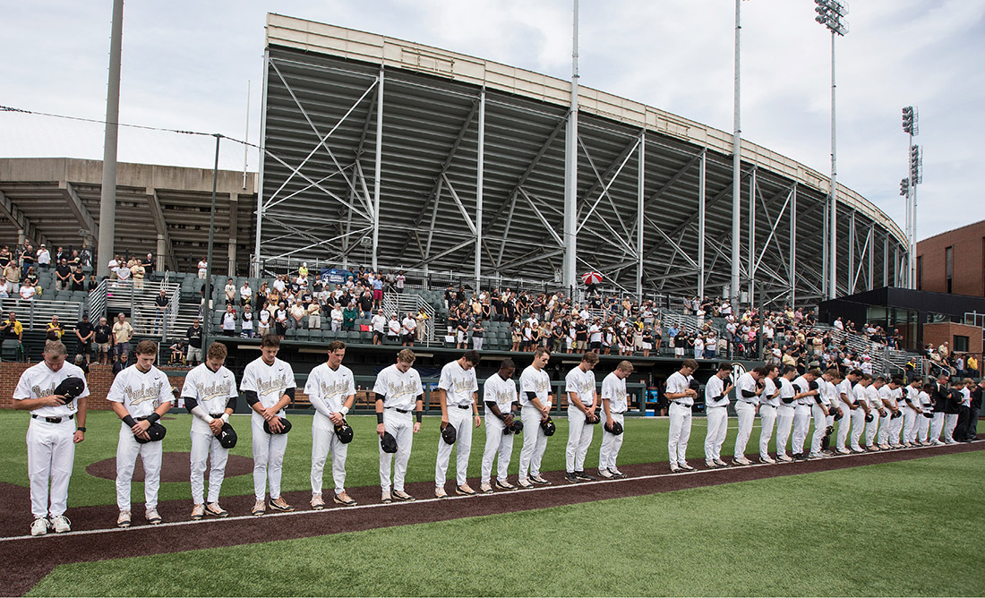 The Commodores honor Donny Everett's memory June 4 on Hawkins Field at the NCAA Regional game against Xavier, the first game played after Everett's death. The empty space in the players' lineup represented their missing teammate. (JOE HOWELL)