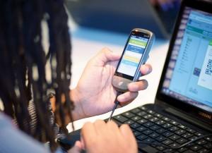 Photo of hand holding smart phone