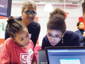 Photo of African American girls at desktop computer