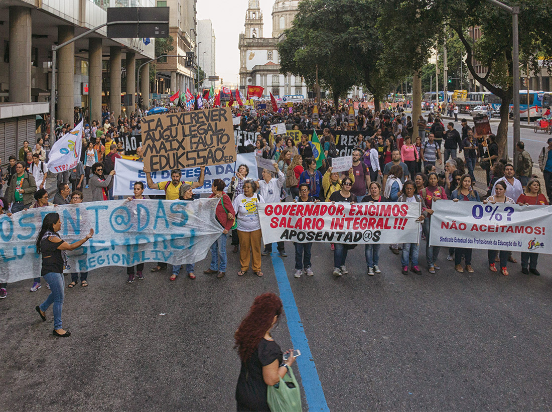 Thousands of Brazilians take to the streets of Rio de Janeiro on June 16 to protest the government of Acting President Michel Temer. As the Summer Olympics near, and the nation's political and economic climate worsens, protests by student groups and political activists are increasing. (SIPA USA VIA AP)