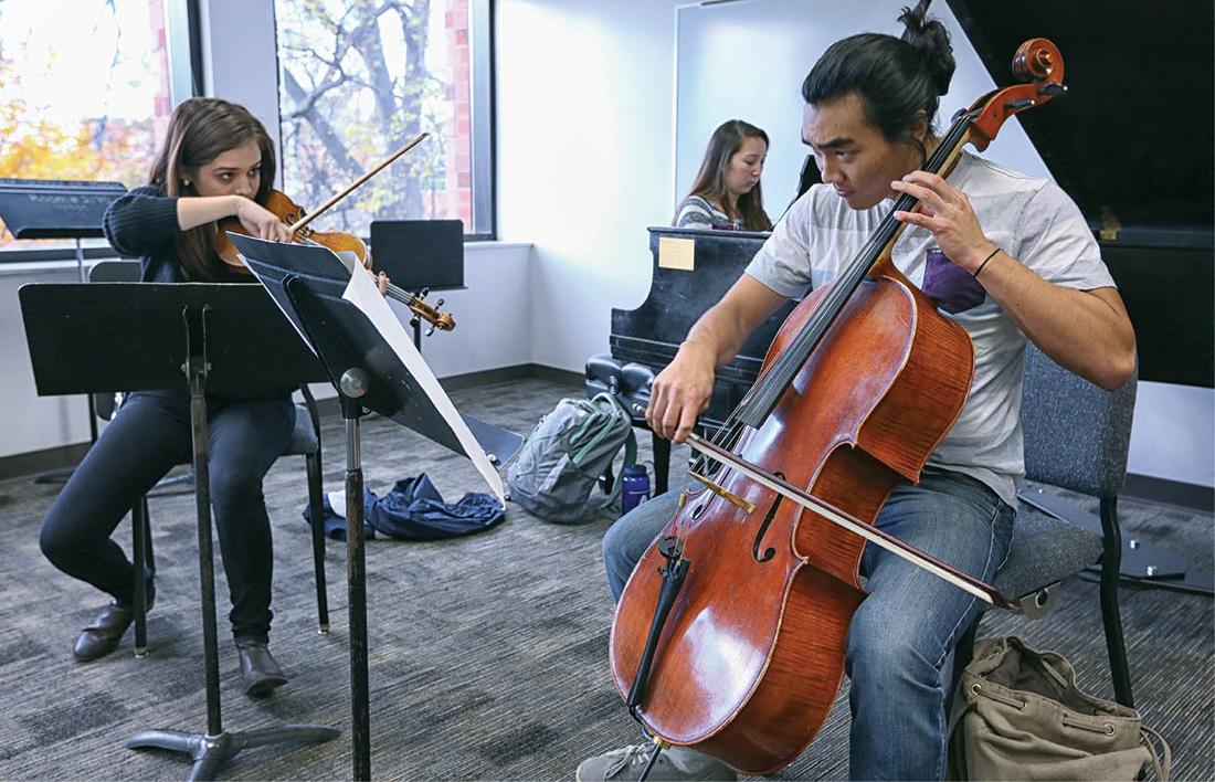 Sabrina Bradford (violin), Antonia Rohlfing (piano) and Blake Kitayama (cello) rehearse their chamber music piece at the Blair School. Photo by Anne Rayner