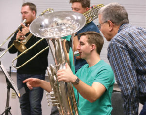 Left to right: Isaac Johnson (trombone), Sam Anderson (trombone) and Pierce O'Brien (tuba) are coached by Gilbert Long, adjunct associate professor of tuba. Photo by Anne Rayner