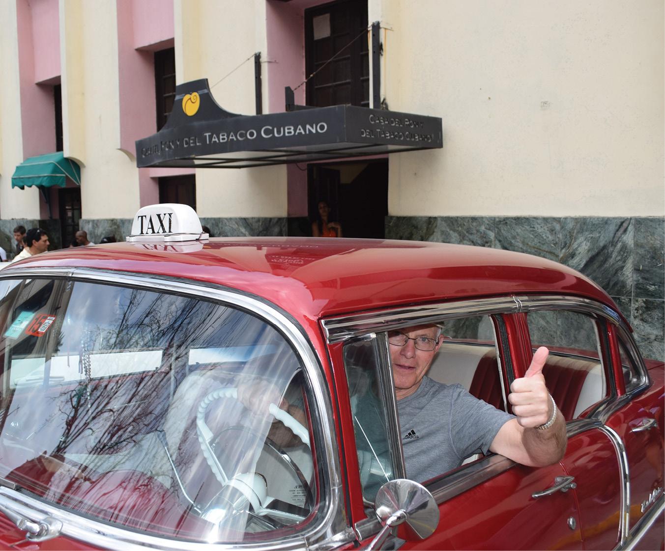 Clair Cramer enjoys a classic car during his Vanderbilt Travel Program trip to Havana, Cuba.