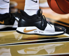 "photo of basketball shoes with ""DW"" written on them"