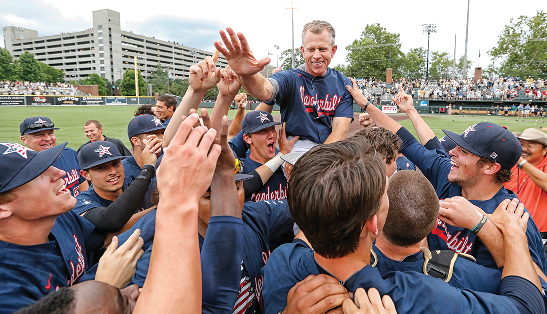 Corbin and players celebrate their NCAA Super Regional victory against Stanford in 2014. The win sent the Commodores to the College World Series, where they won the national championship. (JOHN RUSSELL)