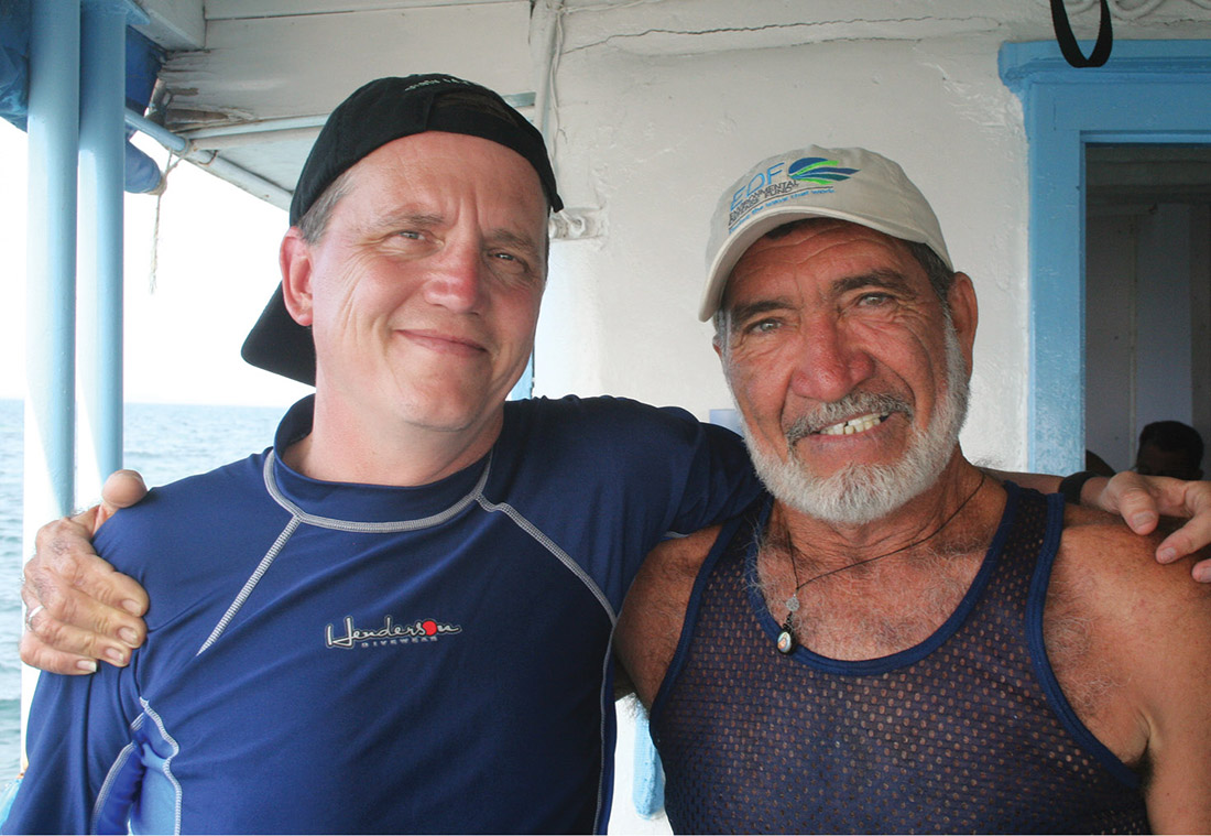 """Whittle, left, joins Capt. Mariel Hechavarria Casas on a Cuban research vessel as part of a """"floating workshop"""" bringing together Cuban, American and Mexican fishermen, scientists and government officials to discuss how to end overfishing and protect marine habitats. (ENVIRONMENTAL DEFENSE FUND)"""