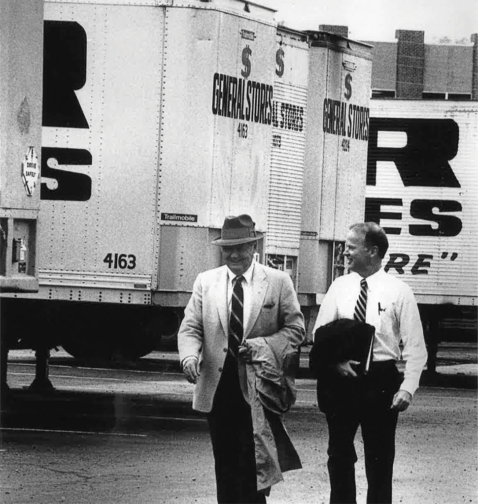 photo of Cal Turner Sr. and Cal Turner Jr. in front of Dollar General trucks