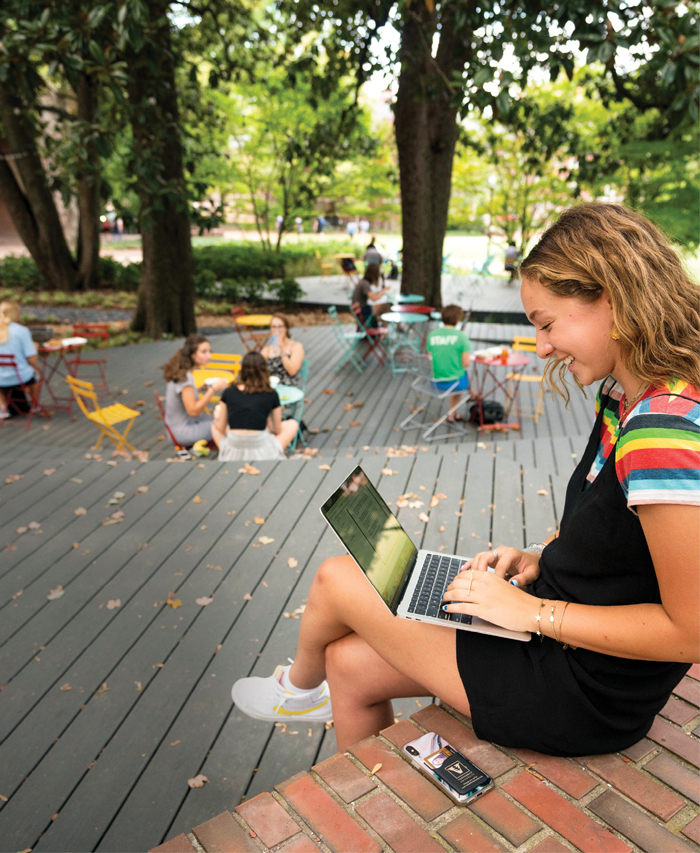 photo of students studying and talking on the Fleming Yard deck