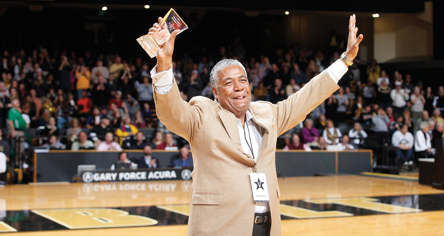 Godfrey Dillard, who played for the Commodore basketball team in 1966–67, grasps his Perry Wallace Courage Award, presented in Memorial Gym Feb. 18 as part of Equality Weekend. Wallace and Dillard broke the SEC color barrier 50 years ago. (JOE HOWELL)