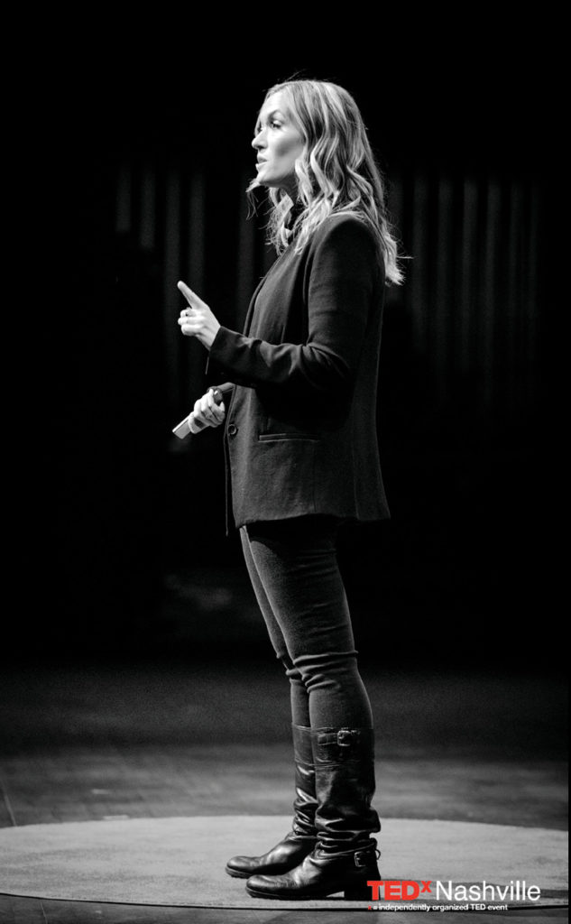 black-and-white photo of Kelly Goldsmith on the TEDx Nashville stage