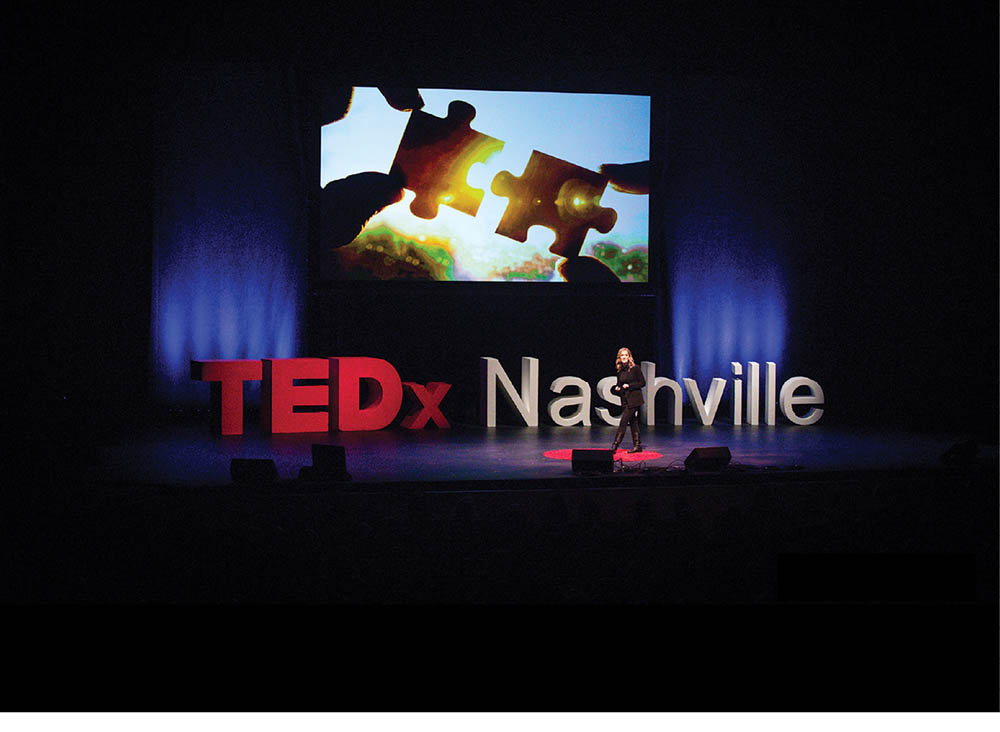 photo of Kelly Goldsmith on stage at a TEDx Nashville event