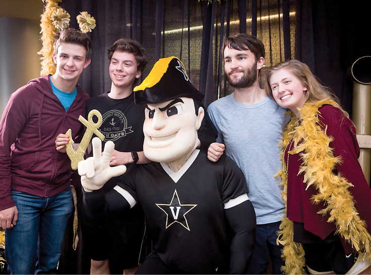 Students pose with Mr. Commodore at this year's Anchor Down Day prior to Giving Day. Photo by Susan Urmy