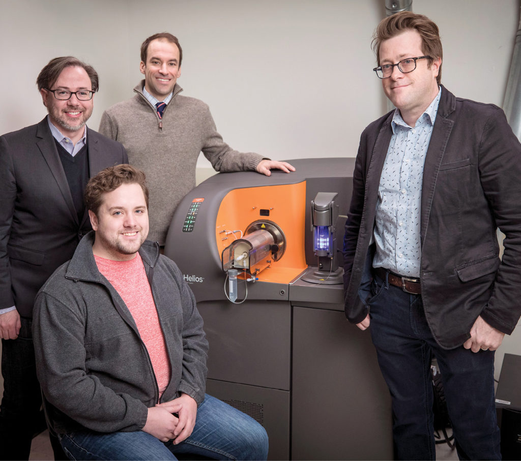 photo of professors Jonathan Irish, Brian Bachmann and fellow researchers