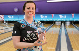 photo of Josie Barnes with a trophy