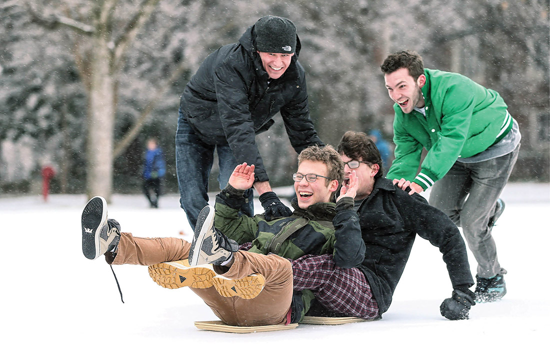 photo of students sledding on lunch trays