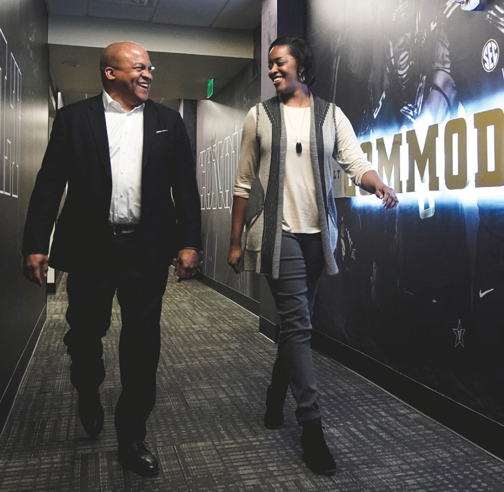 photo of Malcolm Turner and Candice Lee walking down a hallway at the McGugin Center