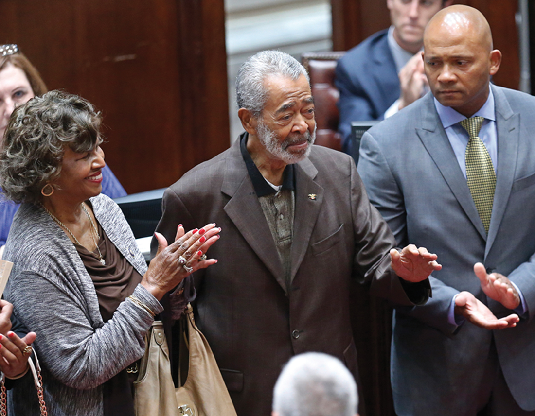 Porter, center, is honored on the floor of the Oklahoma Senate in May 2015. At left is his former wife, Leona Porter, and at right is his son E. Dion Porter. (SUE OGROCKI/AP)