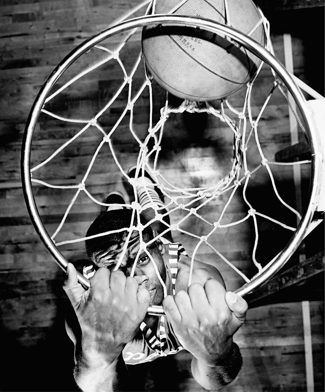 photo of Perry Wallace looking up through basketball hoop