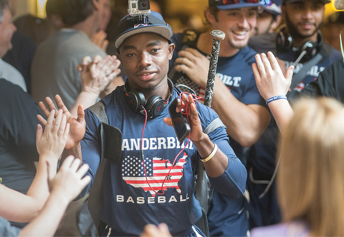 Ro Coleman greets fans June 22, 2015, before a rematch with Virginia at the College World Series.