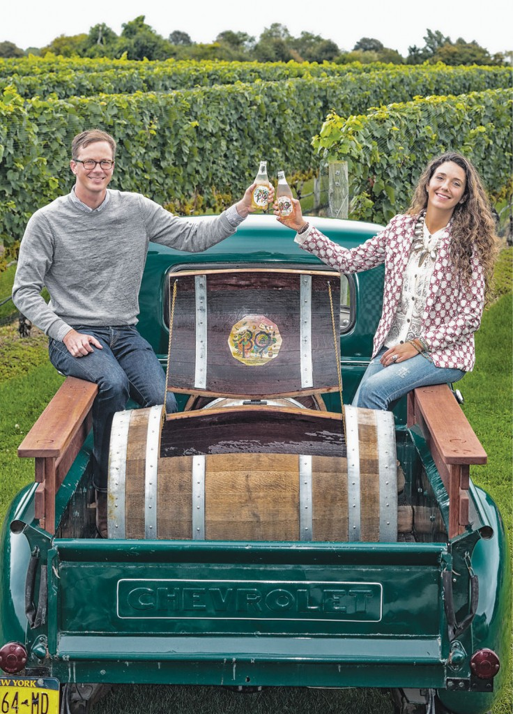 """Max Rohn and Joey Wölffer of Wölffer Estate Vineyard & Stables with their 1949 Chevy """"Cider Truck,"""" complete with custom barrel-cooler for sampling cider onsite. (ERIC STRIFFLER)"""