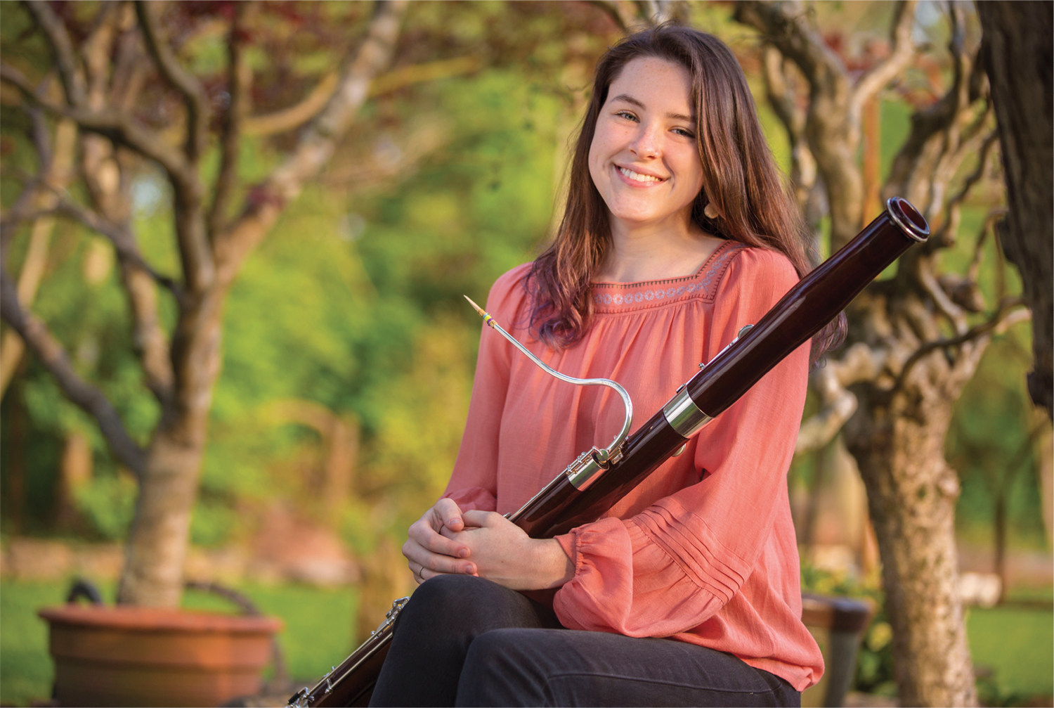 photo of Sarah Robinson holding a bassoon