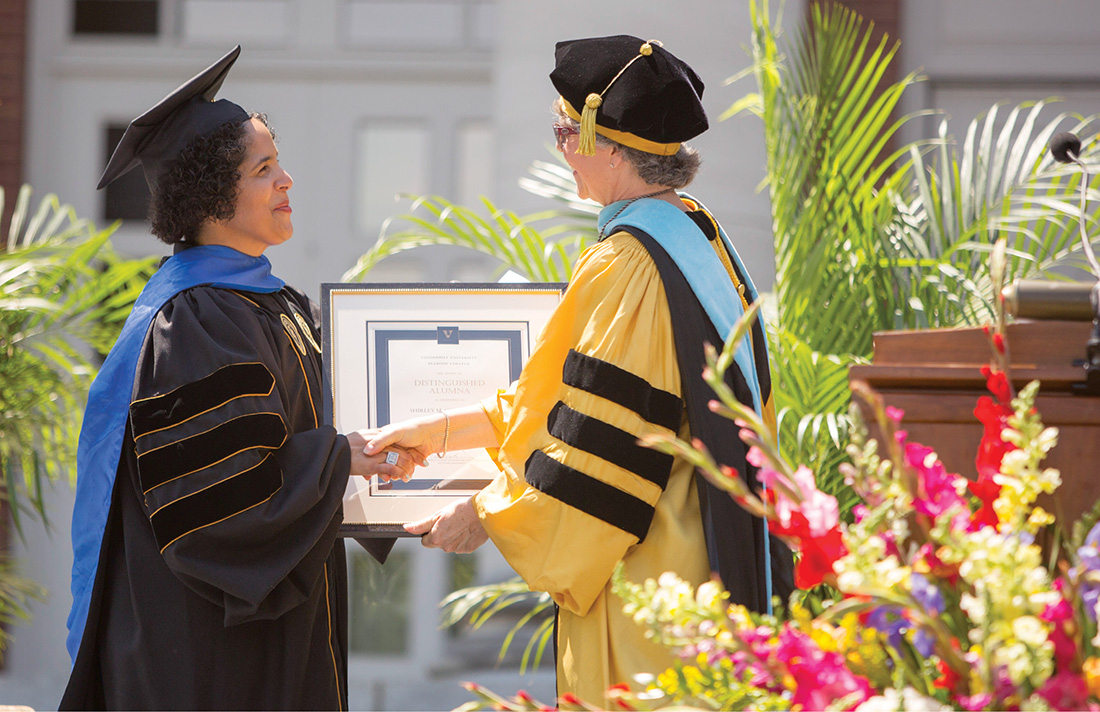 "Camilla P. Benbow, right, the Patricia and Rodes Hart Dean of Peabody College of education and human development, presents Collado with the college's 2015 Distinguished Alumna Award at Commencement. ""My experience at Peabody College was transformative,"" Collado said during her remarks. ""It's where I found my home and my center as I took intellectual, social and cultural risks. Peabody encouraged me to stretch inside myself and out in the world in ways that deeply informed my life's work and personal journey."" (DANIEL DUBOIS)"