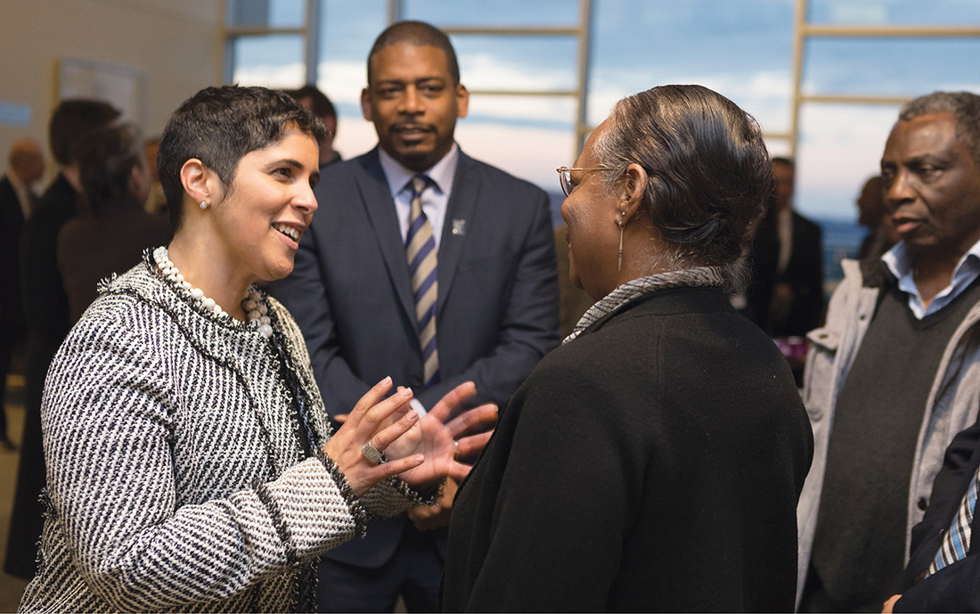 Collado, left, meets faculty and staff of Ithaca College the day her appointment as president was announced. At center is Collado's husband, award-winning poet A. Van Jordan, who now is a distinguished visiting professor at Ithaca. Jordan was recipient of a 2007 John Simon Guggenheim Fellowship and the 2016 Lannan Literary Award in Poetry, among other honors, and is a professor of English language and literature at the University of Michigan. (ADAM BAKER / COURTESY OF ITHACA COLLEGE)