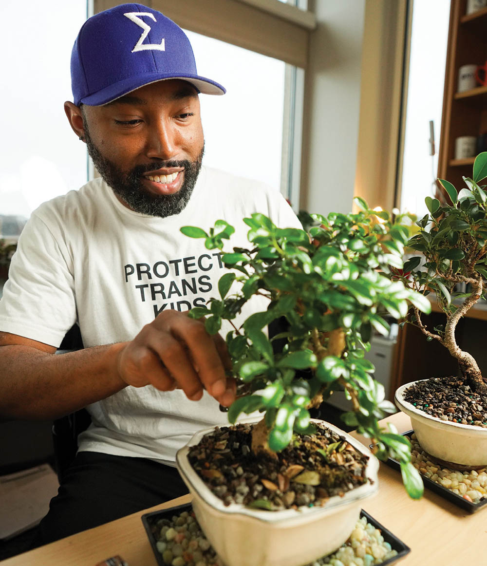 photo of Steven Townsend in a t-shirt and baseball cap trimming a bonsai tree